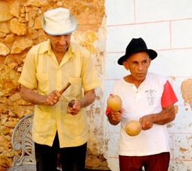 Musicians play in the streets of Cuba