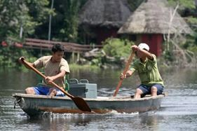 Paddling canoes on the Napo river